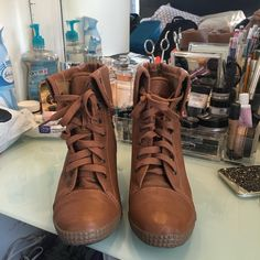 Size 10 camel colored wedge booties Size 10. Worn once. Camel colored. Wedge heel approx 2/3 inches. Use offer button to any offers. Shoes Ankle Boots & Booties