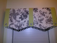 My master bath 'water closet' (I think that's such a silly phrase) valence using two homemade table runners (a friend made them for me) and three drapery tiebacks! Takes a while for friends to figure that out!