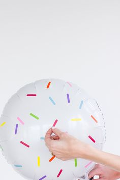 """this is an easy way to make plain balloons more interesting: add sticker """"sprinkles"""""""