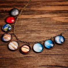 Amazing!!! This #SolarSystem necklace is to die for! Get it at shanalogic: http://www.shanalogic.com/solar-system-necklace.html #handmade #planet #solarsystem #geekchic