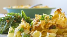 """""""This is a tuna casserole that even my picky family loves! The potato chips give the casserole a crunchy crust.""""  Ingredients     1 (12 ounce) package egg noodles   1/4 cup chopped onion   2 cups shredded Cheddar cheese"""