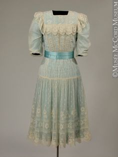 1910's girl's dress. This is a lingerie dress featuring smocked details and lace trim that was common for girls in the 1910's.