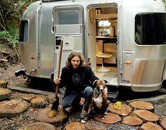 California native, Eddie Vedder, not known to be at all flashy is photographed with his Hipster Airstream Silver Bullet trailer. What else does a surfer, rocker need? #ad