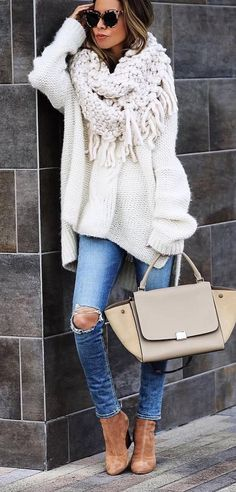 Not that it's get this cold here, but LOVE the scarf and sweater here with skinnys. Would switch to mules instead of heels and don't care for bag