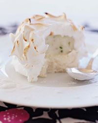 Minty Lime Baked Alaska Recipe from Food & Wine; One Serving 322 cal, gm total fat, 0 gm saturated fat, 74 gm carb, 1 gm fiber. Meringue Desserts, Frozen Desserts, Great Desserts, Healthy Dessert Recipes, Classic Desserts, Healthy Sweets, Baked Alaska Recipe, Lemon Pudding Cake, American Desserts
