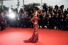 Cheryl Cole dons a red see through floral dress at the Cannes 2013!