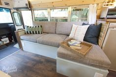 Skoolie living room with a sectional couch! Tiny House Movement // Tiny Living // Tiny House on Wheels // Skoolie // Bus Life // Tiny Home School Bus Camper, School Bus House, Camper Interior Design, Bus Interior, Interior Ideas, Campervan Interior, Bus Living, Tiny House Living, Living Room