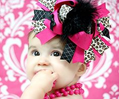 I want a pink and zebra bow like this mom to match Makenna's romper. Please!! :)