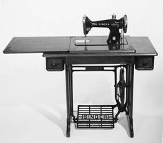 Singer Treadle Sewing Machine - mom made our clothes on this when we were kids.  My sister learned to sew on this and won prizes at the fair for her sewing
