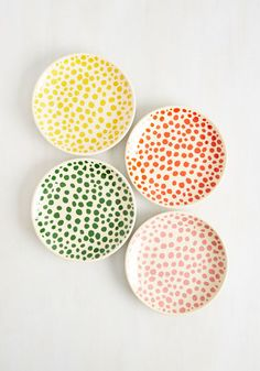 As pals arrive to your place carrying their home-cooked contributions, they hope you'll be serving their eats on these melamine plates. Placing their treats on the dining table, they spy the paprika red, mauve, deep green, and sunny yellow spots of this cream-colored dish set and think, 'how fortuitous'!