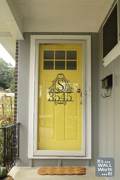 black framed storm door and bright front door (with the house