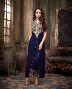 Navy blue front slit suit with embellished pant   1. Navy blue velvet front slit suit2. Comes with matching bottom and dupatta3. Can be stitched upto bust size 42 inches