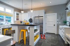 Laundry/craft room ... gray ship lap, white shaker with black hardware, island with barstool seating (island countertop dark gray to hide crafting stains??)