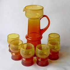 """Serwis do napojów (dzban i 6 kubków) proj. Z.Horbowy – lata 60., HS """"Sudety""""   A set for drinks (a jug and 6 cups), design Z. Horbowy, 60s, HS """"Sudety""""   buy only on Patyna.pl #Sudety #Horbowy #drinks #party #set #colour #glass #jug #fun #orange #Polish #Poland #klasyk #classic #musthave #inspiration #want #retro #vintage #forsale #vintagefinds"""