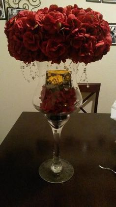 """There are 12 centerpieces in total. These centerpieces were created by myself (the bride). Each centerpiece comes as seen with a silk flower/hanging crystal topper, an led candle inside of a """"candle holder"""", the black rocks at the bottom of the vase, and the vase. Our wedding was inspired by Phantom of the Opera and the flicking led candles fit perfectly. We also used the centerpieces as decoration the guest book table and for cocktail hour since we had extra."""