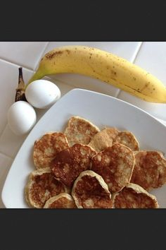 2 eggs + 1 banana = pancakes. Mash one banana. Crack two eggs. Mix banana & eggs together. Spray griddle with Pam and pour batter. Flip once & done.