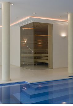 glass sauna with pool indoor. more photos from http://www.sopra.de/wellness/saunabau/sauna-bau-angebot/