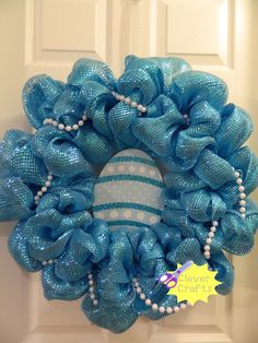 easter wreath... can be personalized with name on the egg.... Check us out on facebook Clever crafts
