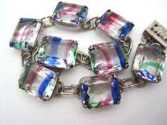 Art Deco bracelet. It features iris glass stones set in sterling silver.