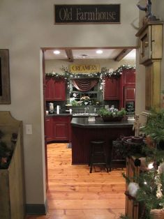 Looove the red cabinets with the light wood floor and black center island! I am painting my new kitchen these same colors!!!