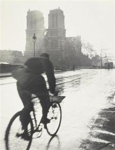 Tore Johnson :: Untitled [cyclist by Notre Dame], Paris, 1949  / more[+] by this photographer