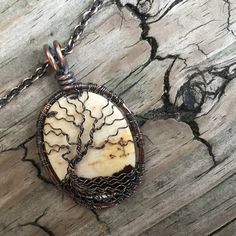 Antique Copper Wire Wrapped Tree of Life over Coconut Jasper Cabochon Handcrafted by Ann White.  The pendant is Large and hangs 1 3/4 inches (42mm) from the top of the bail and is 1 inch (25mm) wide.