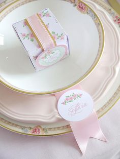 This Must Be the Place - The place cards are as easy to make as they are pretty. Add your text to our printable tags using word processing software and secure them to pieces of pink satin ribbon using hot glue or double-sided tape. Romantic DIY Wedding Ideas on HGTV