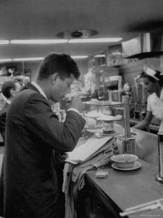 Senator John F. Kennedy Drinking a Cup of Coffee at a Cafe in Washington Airport Photographic Print