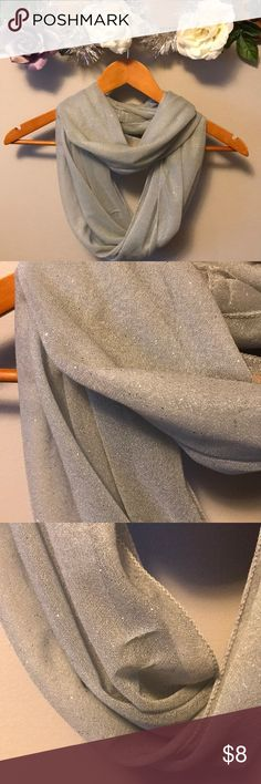 🧣 Sparkle Scarf🧣 This is a light gray sparkly scarf. Infinity style. Imperfections. See last two pics.Obviously can be hidden. Accessories Scarves & Wraps