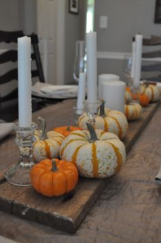 Fall/Thanksgiving Table with pumpkins and wood. Rustic with candles