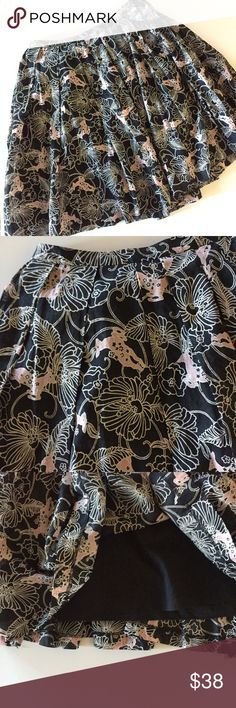 """Club Monaco deer and floral print full skirt How adorable is this skirt?! Light pink fawn print on a black background. Full cut with pleats. Lined, 100% cotton. Excellent condition! Falls just below the knee on me (I'm 5'7""""). Measures 14.5"""" across waist and 24"""" long. Club Monaco Skirts A-Line or Full"""