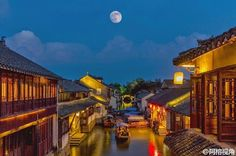 An ancient Chinese watertown on a Moon Day night