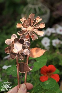 How to make DIY copper garden art flowers as weatherproof ornaments from the garden using a die cutting machine and sheets of copper.
