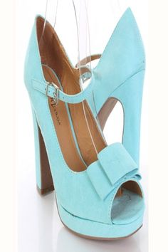 These adorable heels are a must have! Featuring smooth faux suede with stitched detailing, bow vamp, peep toe, mid strap with buckle, smooth lining, and cushioned footbed. Approximately 5 inch flared heels and 1 inch platforms. 1213