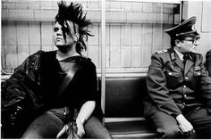 East German punk taking the U-Bahn next to an Volkspolizei officer, East Berlin, East Germany (1986)
