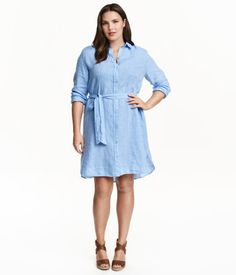 Shirt dress in soft linen with a collar, buttons at front, and a tie belt at waist. Long sleeves with buttoned cuffs.