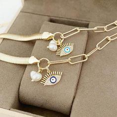 Evil Eye Bracelet, Gold Oval Link Chain Bracelet, Gold Snake Bracelet #evileye #evileyes #evileyebracelet #evileyejewelry #adjustablebracelet #greekjewelery #nazarboncuk #nazarbeads #greekevileye #bracelet #snakechain #pearlcharm #eyeshapedbracelet #evileyebangle #goldbracelet Snake Bracelet, Evil Eye Bracelet, Pearl Bracelet, Evil Eye Jewelry, Adjustable Bracelet, Blue Beads, Charmed, Eye Protection, Jewellery