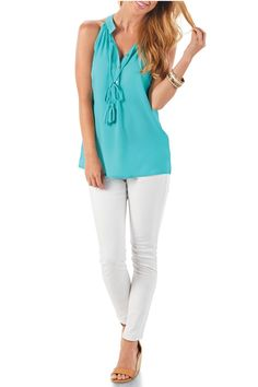 """This textured poly-crepe racerback tank features hanging tassel ties at the neck and three mother-of-pearl shell buttons at the placket.  Measures approximately 24"""" from shoulder to hem on size small.  Turquoise Tassel Tank by Mud Pie. Clothing - Tops - Tees & Tanks Clothing - Tops - Sleeveless Virginia"""