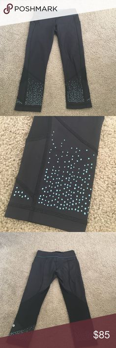 RARE Lululemon Fast and Free Tight 7/8 length legging (fitted). Perfect condition. Lulu symbol on lower leg. Mesh on back of legs and green polka detail on front. Side pockets as well as one on back of waistband and two in front of waistband. Stock photo doesn't show actual leggings with green polka dots! It just shows how it would fit! lululemon athletica Pants Leggings