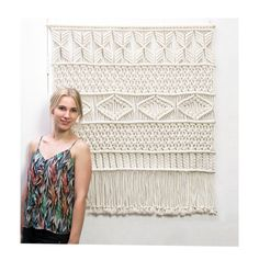 This gorgeous handmade macrame wall hanging is made with neutral cotton macrame cord. With this macrame wall hanging youll instantly add a bohemian vibe to your room an it will really warm up a space. -------------------------------------------------------------  This macrame wall hanging measures about:  Dowel length: 97 cm ( 38 inches ) Macrame height: 107 cm ( 42 inches )  This item is made to order. It takes 12-14 days to make this beautiful wall hanging for you.  => Looking for o...