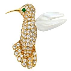 VAN CLEEF & ARPELS . 18K Yellow Gold, Diamond, Pearl & Emerald Hummingbird brooch.Circa 1960s