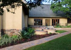 Set on manicured grounds, Lapeng Lodge is neatly tucked away between the mountains in a beautiful and tranquil environment close to Burgersfort, Limpopo. Lodge Wedding, Wedding Venues, Environment, Patio, Mansions, House Styles, Outdoor Decor, Image, Beautiful
