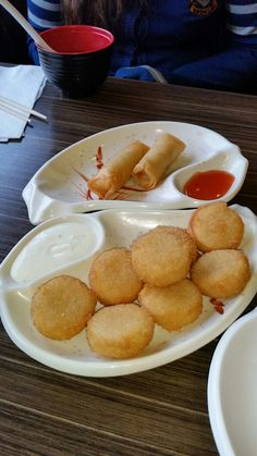 Deep fried scallops and spring rolls.