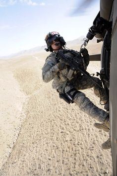 U.S. Army Sgt. Patrick Modesitt, a flight medic for the Colorado National Guard's 2d Battalion, 135th Aviation Regiment, gets ready to perform his combat hoist during training from their UH-60 Black Hawk helicopter Aug. 9 in Herat province, Afghanistan.