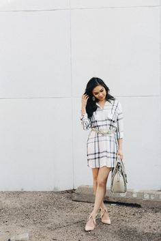 Wearing a longer plaid shirt as a dress. Just make sure it covers your bum and add a belt to cinch in the waist to keep your shape.