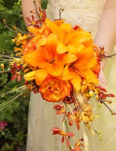 orange wildflower bouquets   Orange Bouquet Wedding Flowers Photos & Pictures - WeddingWire.com