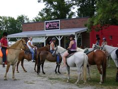 """Our Southern Fried Equestrian Friends ride up on their horses and tie up to the hitching post. Sometimes we even offer """"curb"""" side service and bring their goodies right to them so they don't even have to get off their horse!"""