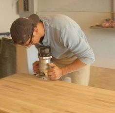 creating custom high end butcher block counter tops for cheap, countertops, diy, how to, kitchen design, woodworking projects, The first thing we did after cutting the counter tops to length was route the exposed edges with a French Baroque bit