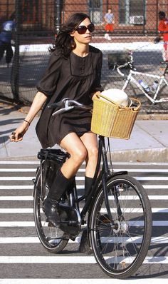 images of Famke Janssen Black Dress Out And About Bike With Her Dog