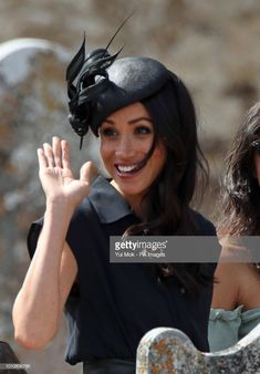 Meghan s Philip Treacy black straw hat from Collection.The Duchess of  Sussex arrives to attend the wedding of Charlie van Straubenzee and Daisy  Jenks at St ... 77428140a555
